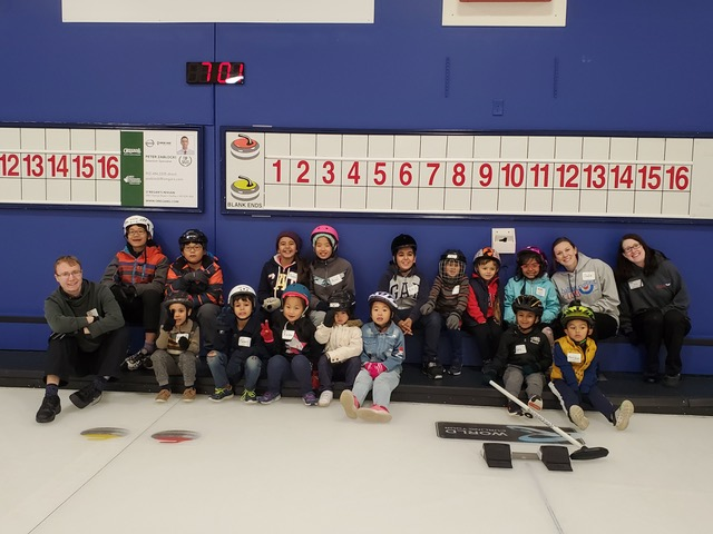 Kids on curling ice